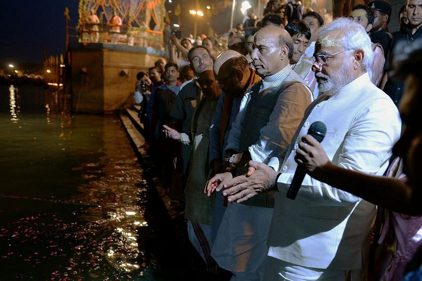 """Indian Prime Minister Narendra Modi (right) performs the """"Ganga Puja"""" religious ritual with Bharatiya Janata Party (BJP) President Rajnath Singh (second right) and other senior BJP leaders on the banks of the River Ganges.India's new government"""