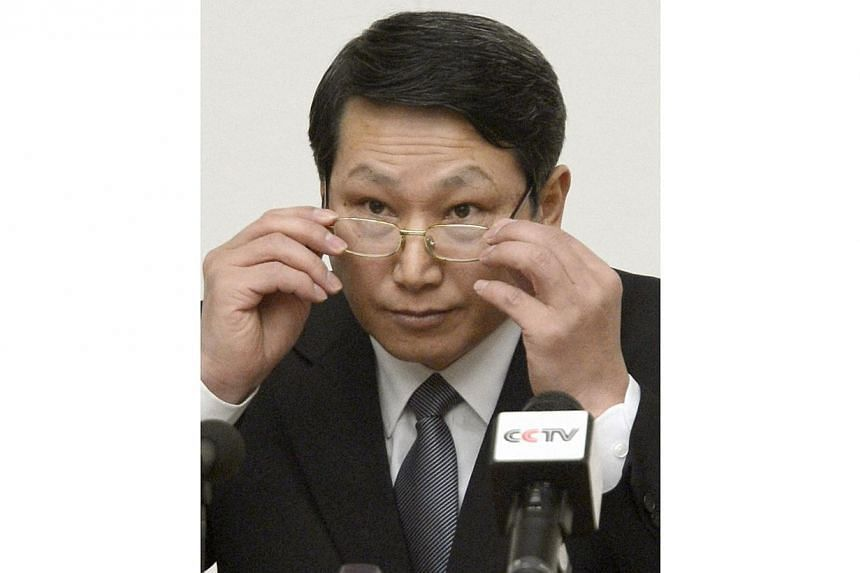 South Korean missionary, identified by the North as Kim Jong Wook, adjusts his glasses during a news conference in Pyongyang on Feb 27, 2014. North Korea on Thursday, June 12, 2014, rejected Seoul's call for talks on the fate of a South Korean m