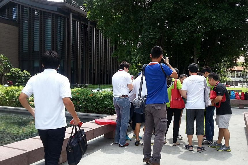 Participants of a Heritage Race which consisted of 20 uniquely-Singaporean sites in Balestier. -- ST PHOTO: AUDREY TAN