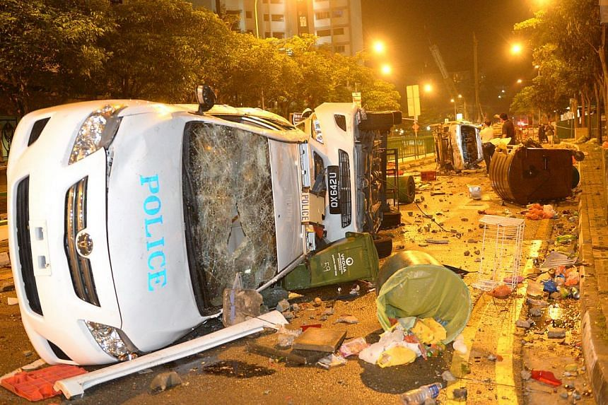 The debris of the police patrol cars after a riot that broke out at Little India on 8 December 2013. -- PHOTO: ST FILE