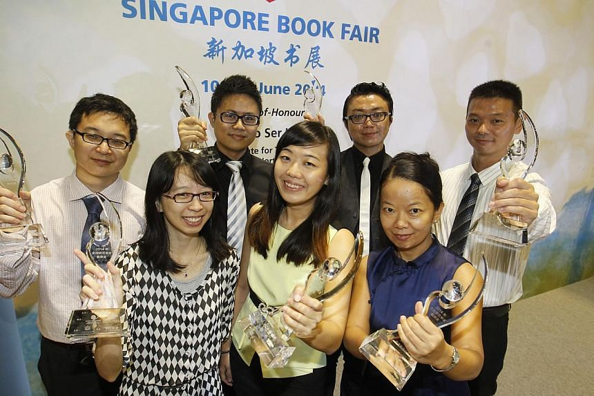 The award winners at the ceremony held during the launch of the Singapore Book Fair yesterday were (front row, from left) Ms See Hui Chen, Ms Hoe Mei Hwee and Madam Dong Yan; (back row, from left) Mr Liu Zhao, Mr Liong Peen Lee, Mr Chong Yew Fook and