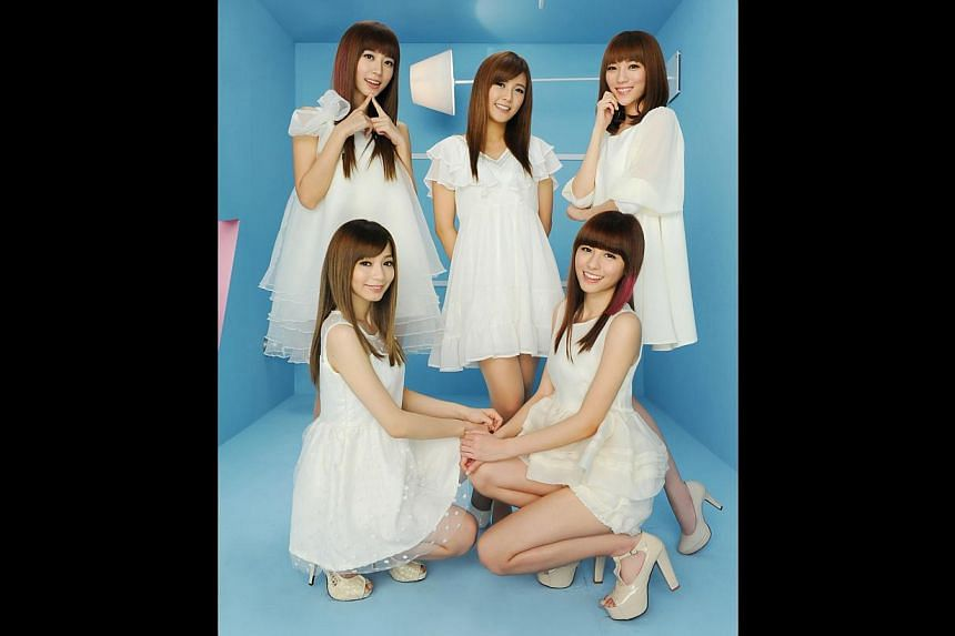 Members of Taiwanese girl group Popu Lady, (front, from left) Bao Er and Liu Yu-shan and (back, from left) Hung Shih, Da Yuan and Ting Hsuan, reportedly underwent training for a year before making their debut in 2012. -- PHOTO: HIM MUSIC