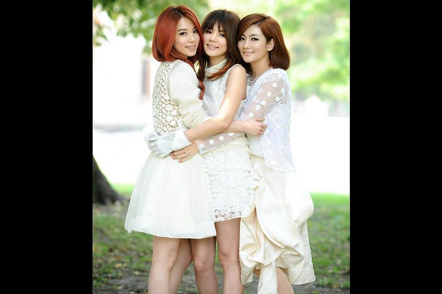 S.H.E members (from far left) Hebe, Ella and Selina have been on top of their game and are still going strong after 13 years. -- PHOTO: HIM MUSIC