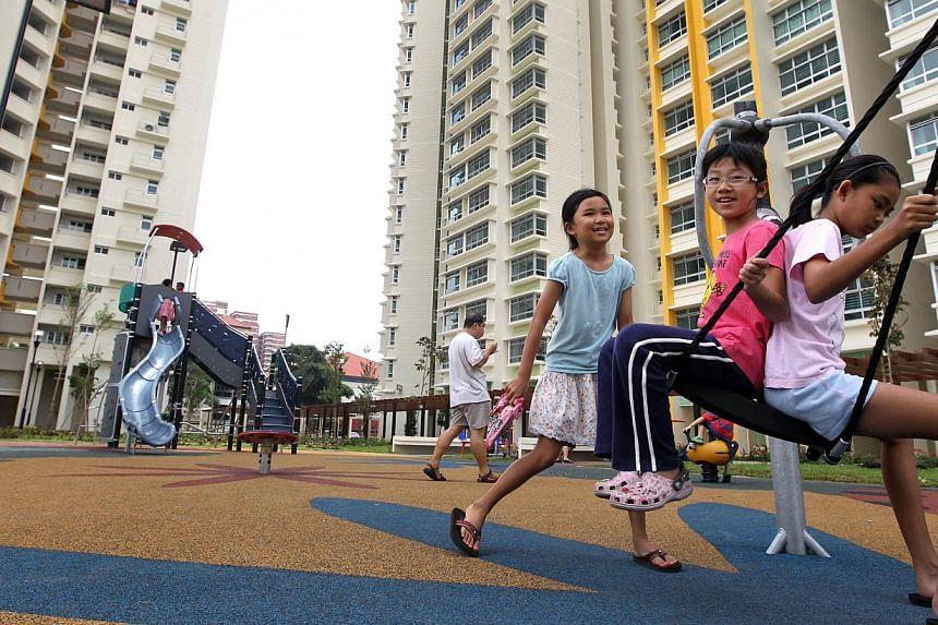 Children enjoying the playground facilities at Dawson Estate in Queenstown. -- PHOTO: ZAOBAO