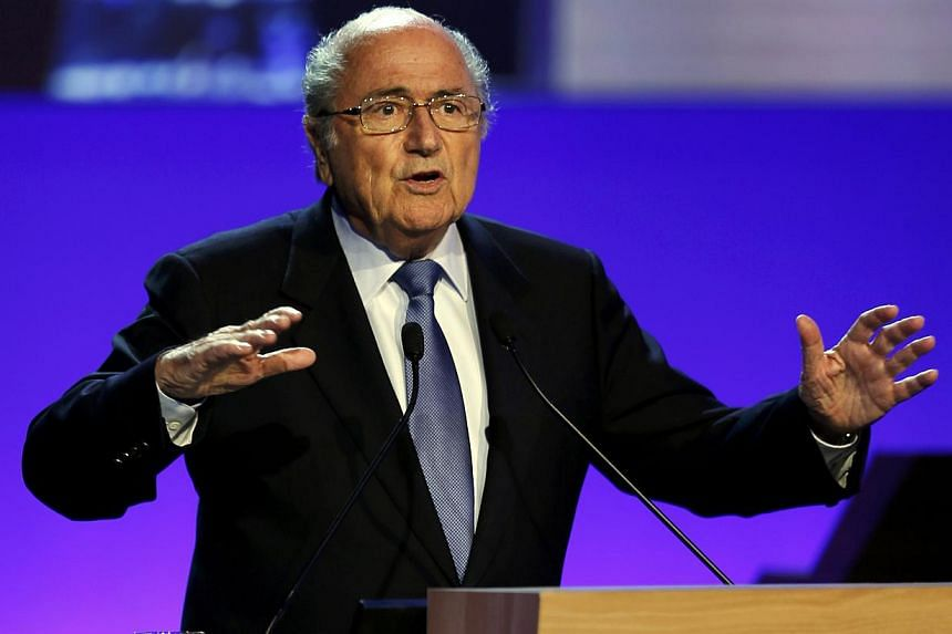 FIFA President Sepp Blatter delivers a speech during the opening ceremony of the 65th FIFA Congress in Sao Paulo on June 11, 2014. -- PHOTO: REUTERS