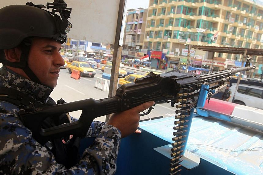 An Iraqi policeman mans a checkpoint in the capital Baghdad on June 12, 2014. -- PHOTO: AFP