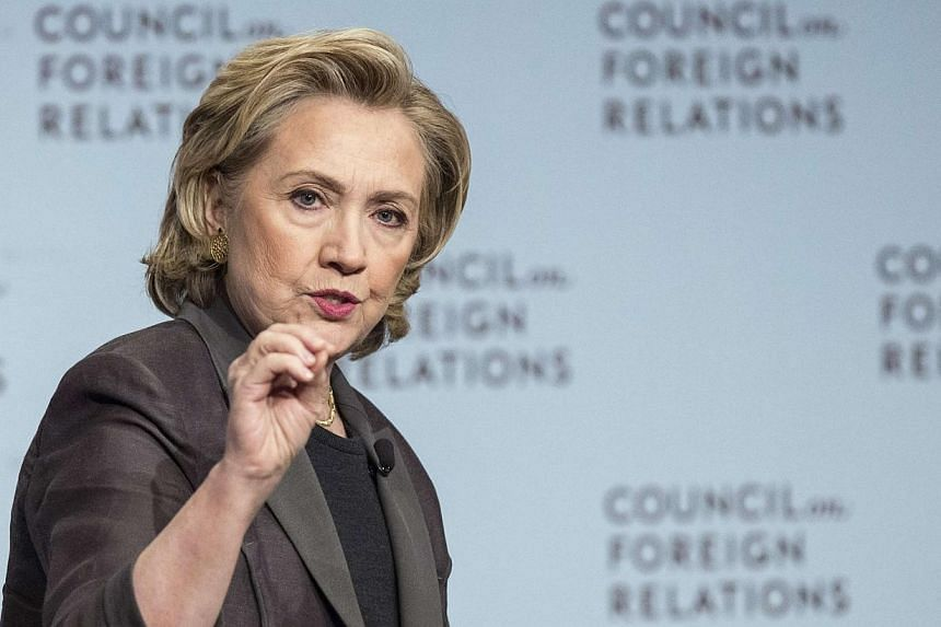"""Former US Secretary of State Hillary Clinton participates in """"A Conversation with Hillary Rodham Clinton"""" at the Council on Foreign Relations (CFR) in Manhattan, New York on June 12, 2014. -- PHOTO: REUTERS"""