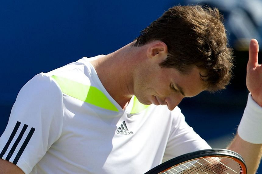 Britain's Andy Murray reacts after losing a point against Czech Republic's Radek Stepanek of the during their third round match on the fourth day of the ATP Aegon Championships at the Queen's Club in west London on June 12, 2014. -- PHOTO: AFP