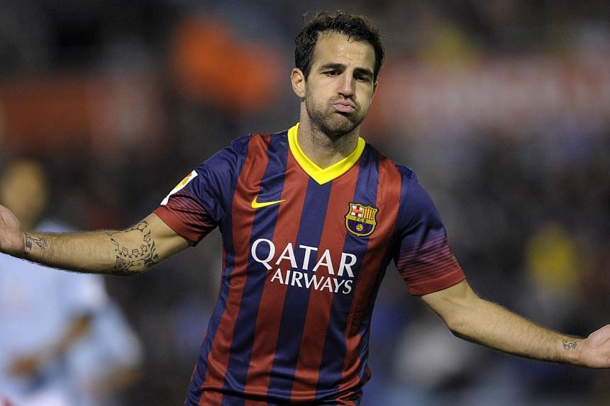 A file picture taken on October 29, 2013 shows Barcelona's midfielder Cesc Fabregas celebrating after scoring during the Spanish league football match RC Celta de Vigo vs FC Barcelona at the Balaidos stadium in Vigo. Spanish giants Barcelona have agr