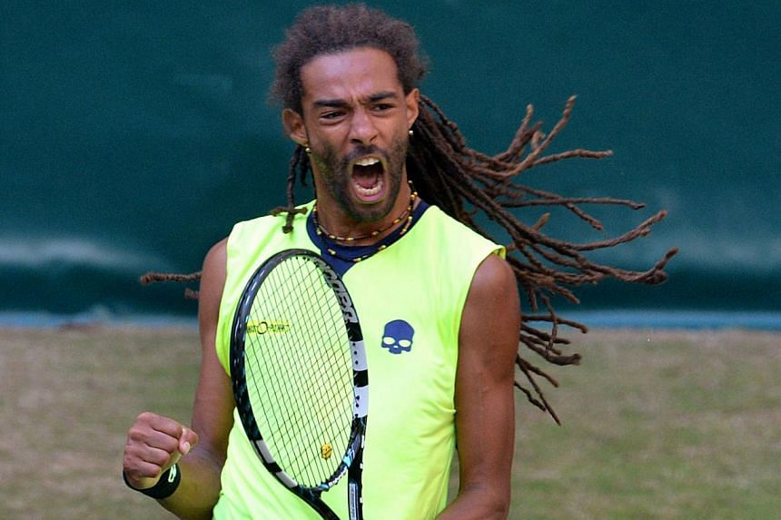 German Dustin Brown celebrates a point during his second round tie match against Rafael Nadal of Spain at the ATP Gerry Weber Open tennis tournament in Halle, western Germany on June 12, 2014. -- PHOTO: AFP