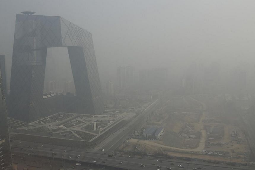 The China Central Television (CCTV) building is seen next to a construction site in heavy haze in Beijing's central business district on Jan 14, 2013. More than a quarter of all companies covered by Beijing's municipal carbon laws ignored a key