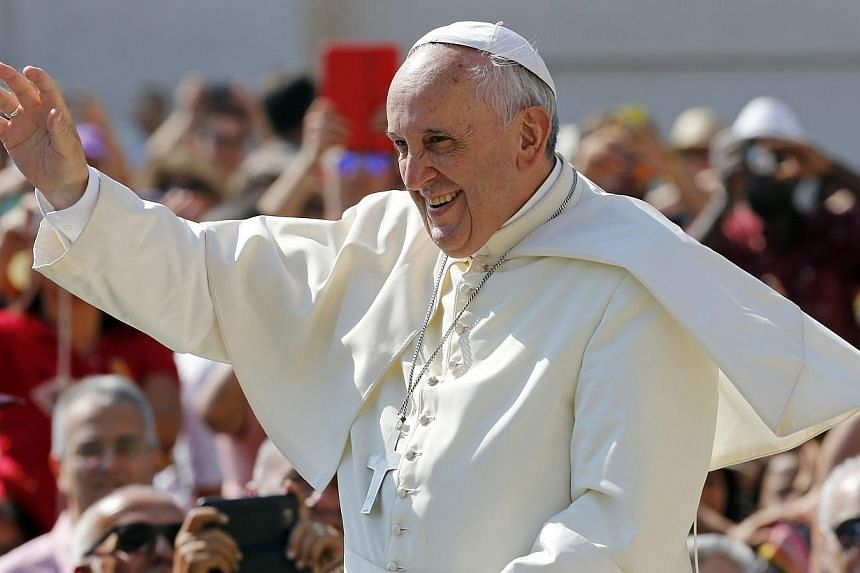 Pope Francis waves as he arrives to lead his weekly general audience at St. Peter's Square at the Vatican on June 11, 2014.Pope Francis said in an interview on Friday, June 13, 2014, that he will ask God's advice when the time comes to consider