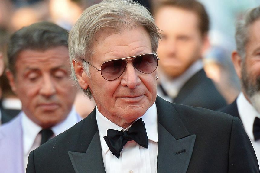 """Member of the cast of """"The Expendables 3"""", US actor Harrison Ford poses on the red carpet during the 67th edition of the Cannes Film Festival in Cannes, southern France, on May 18, 2014. -- PHOTO: AFP"""