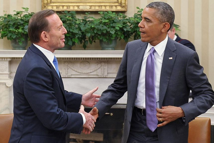 US President Barack Obama and Australian Prime Minister Tony Abbott shake hands following a bilateral meeting in the Oval Office of the White House in Washington, DC on June 12, 2014. -- PHOTO: AFP
