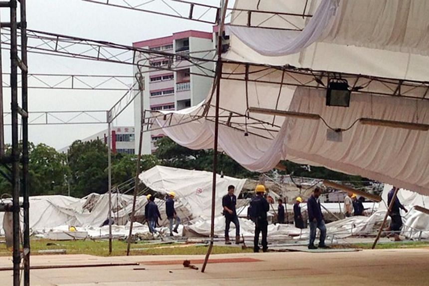 The storm brought down a night market tent in Geylang (left) as well as trees and branches islandwide, including in Kent Ridge (above).