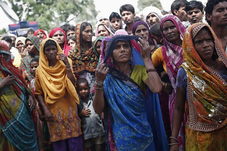 Onlookers gathering on May 31 at the site where two teenage girls, who were answering nature's call, were raped and killed at Budaun district in Uttar Pradesh. Sanitation is a tough challenge as India's population keeps outgrowing the pace of toilet