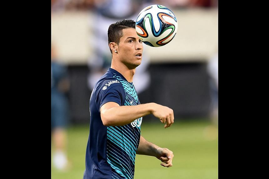 Threats at goal include Portugal's supernuke Cristiano Ronaldo, who is worth five aircraft carriers alone in World Cup terms. -- PHOTO: AGENCE FRANCEPRESSE