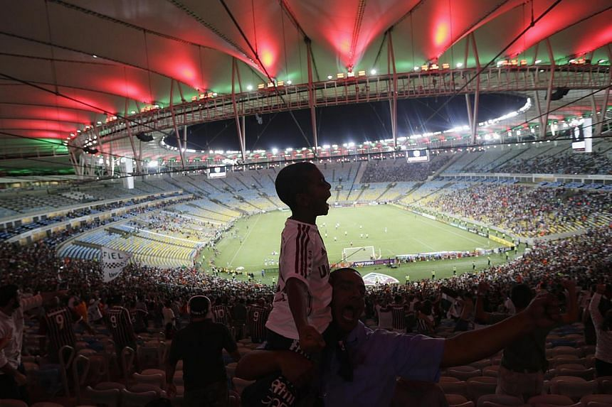 Feel the heat and rhythm at Maracana stadium in Rio de Janeiro, which will host this year's World Cup final. -- PHOTO: REUTERS