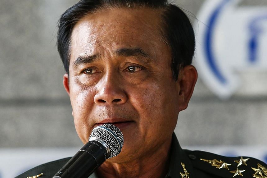 Thai Army chief General Prayuth Chan-ocha speaks during a news conference after the army declared martial law nationwide to restore order, in Bangkok on May 20, 2014. Thailand may have an interim government by August, he said. --PHOTO: REUTERS