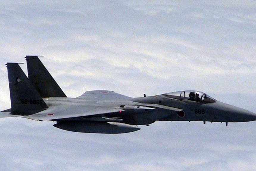 This photo taken on June 11, 2014, released by China's Ministry of National Defence, shows a Japanese F-15 jet approaching a Chinese plane (out of frame) in a spot where the two countries' air defence zones overlap. Japan summoned the Chinese ambassa