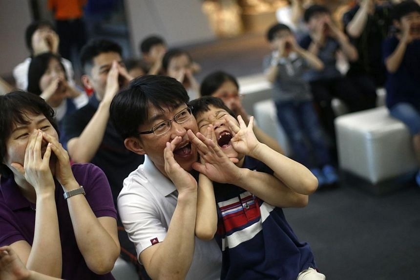 Children participate in a fire safety course with their parents at a safety experience centre in Seoul on June 4, 2014. -- PHOTO: REUTERS