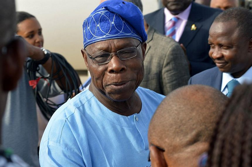 Nigeria's former president Olusegun Obasanjo (centre) told media some of the schoolgirls kidnapped by militant group Boko Haram in April may never return, in the most pessimistic comments yet on their fate from a member of the political elite. -- PHO
