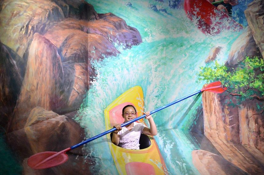 Ng Hsin Rong, 10, in a Kayak at Alive Museum at Suntec City Mall on June 9, 2014. -- PHOTO: LIM YAOHUI FOR THE STRAITS TIMES