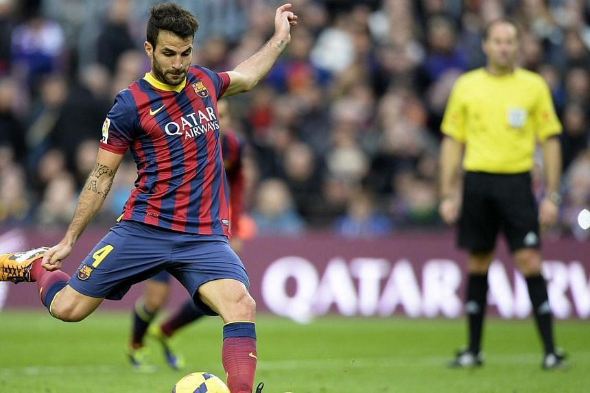 Barcelona midfielder Cesc Fabregas scores against CF Granada at the Camp Nou stadium in Barcelona. Arsenal manager Arsene Wenger is surely making a mistake letting Fabregas move to Chelsea. -- PHOTO: AFP