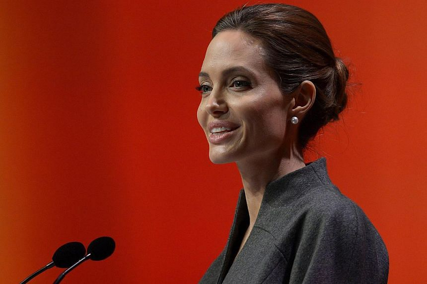 US actress and special UN envoy Angelina Jolie delivers her speech on the fourth day of the Global Summit to End Sexual Violence in Conflict in London on June 13, 2014. -- PHOTO: AFP