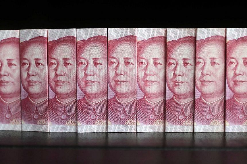 Chinese 100 yuan banknotes. On Friday, the Monetary Authority of Singapore announced more initiatives to promote Singapore as an offshore yuan hub. -- PHOTO: REUTERS