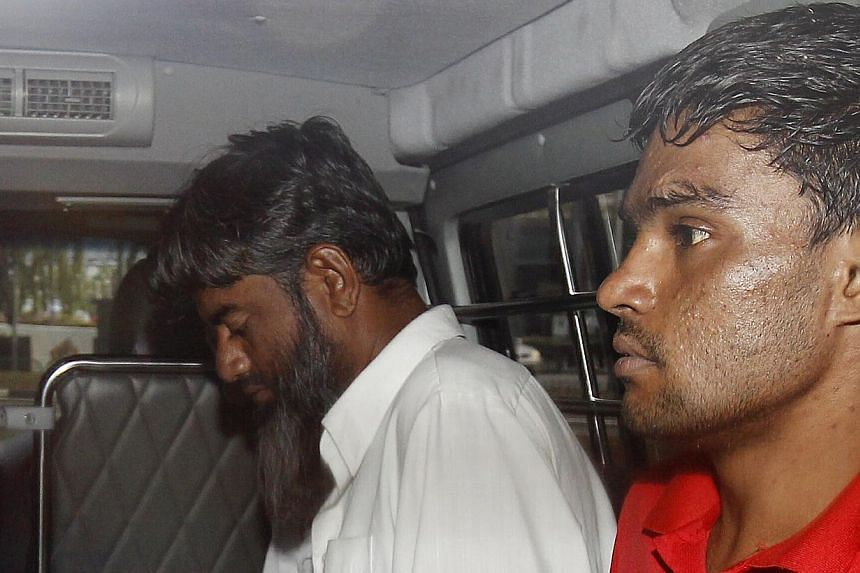 (From left) The two Pakistanis Rasheed Muhammad, 43, and Ramzan Rizwan, 25, who are accused of murder. -- ST PHOTO: WONG KWAI CHOW