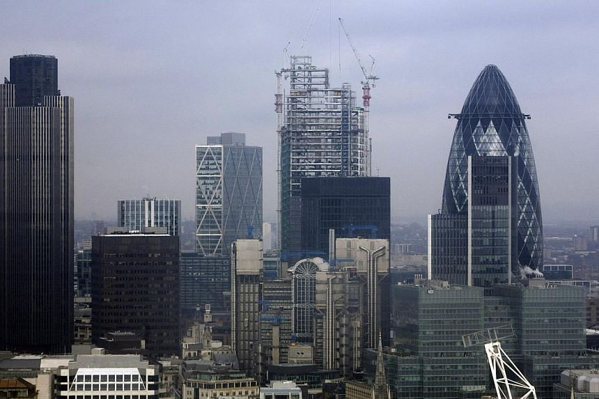 The skyline of London. Standard & Poor's lifted on Friday its outlook on Britain's credit rating to stable from negative, citing the broad recovery and progress in consolidating public finances, and confirmed its top 'AAA' assessment. -- PHOTO: B