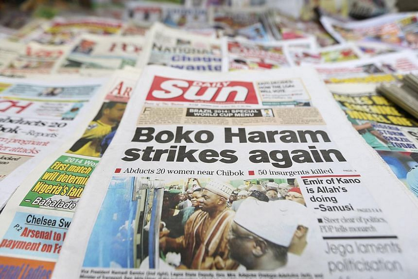 A newspaper with its frontpage headline on an abduction of women from a village in northeast Nigeria, is displayed at a vendor's stand along a road in Ikoyi district in Lagos on June 10, 2014. -- PHOTO: REUTERS