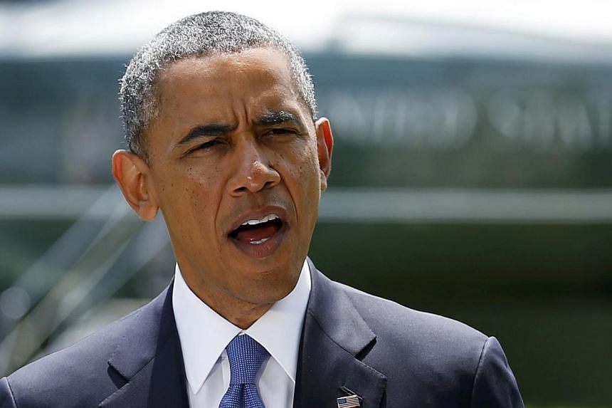 US President Barack Obama delivers a statement on the situation in Iraq, prior to departing the White House South Lawn in Washington on June 13, 2014. -- PHOTO: REUTERS