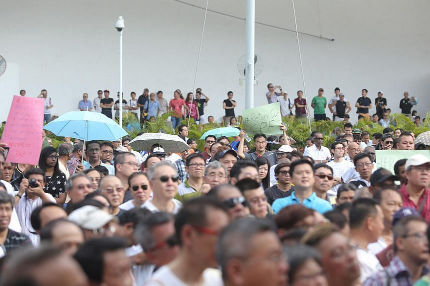 """A """"Return Our CPF"""" protest at Hong Lim Park last week. For all the grumbling, the majority of Singaporeans are too pragmatic to opt for unbridled welfarism at the next elections, which will take place by 2016. -- ST PHOTO: ONG WEE JIN"""