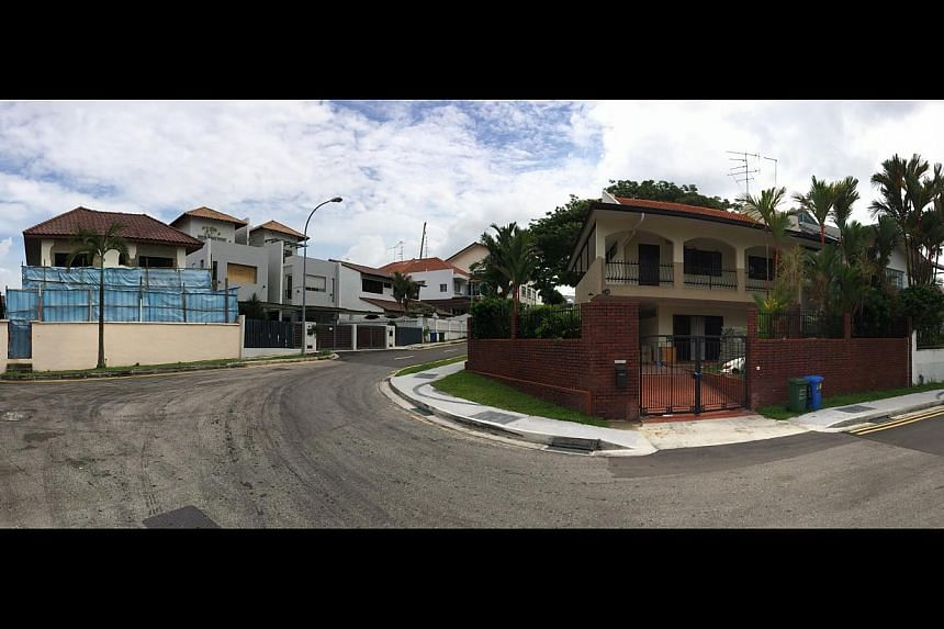 A house under construction (above left) and another seemingly unoccupied (above right) in Aroozoo Avenue, which is in the affected area, along with Blocks 158 to 161 (below) in Hougang Street 11. The 17 conjoined clusters stretch from Hougang Avenue