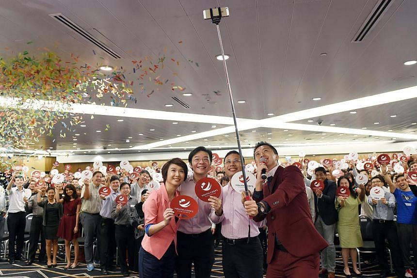 (Foreground, from left) Ms Low Yen Ling, Parliamentary Secretary for Culture, Community and Youth; Mr Lawrence Wong, Minister for Culture, Community and Youth; Mr Desmond Lee, chairman of the Youth Corps Singapore Advisory Committee, and event emcee