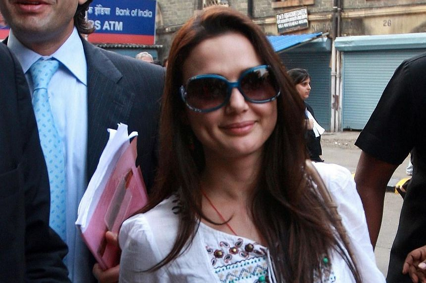 Bollywood actress Preity Zinta leave the High Court in Mumbai after filing a petition relating to an Indian sports team on Dec 2, 2010. -- PHOTO: AFP
