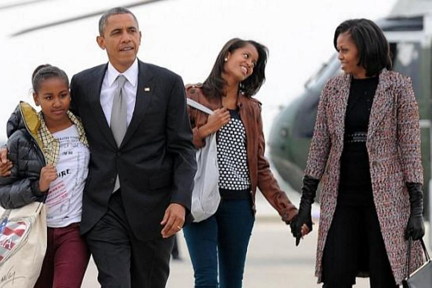 In this November 7, 2012 file photo US President Barack Obama, First Lady Michelle Obama and their daughters Malia and Sasha(left) borad Air Force One at Chicago O'Hare International Airport in Chicago. Father's Day is the day we use to speciall