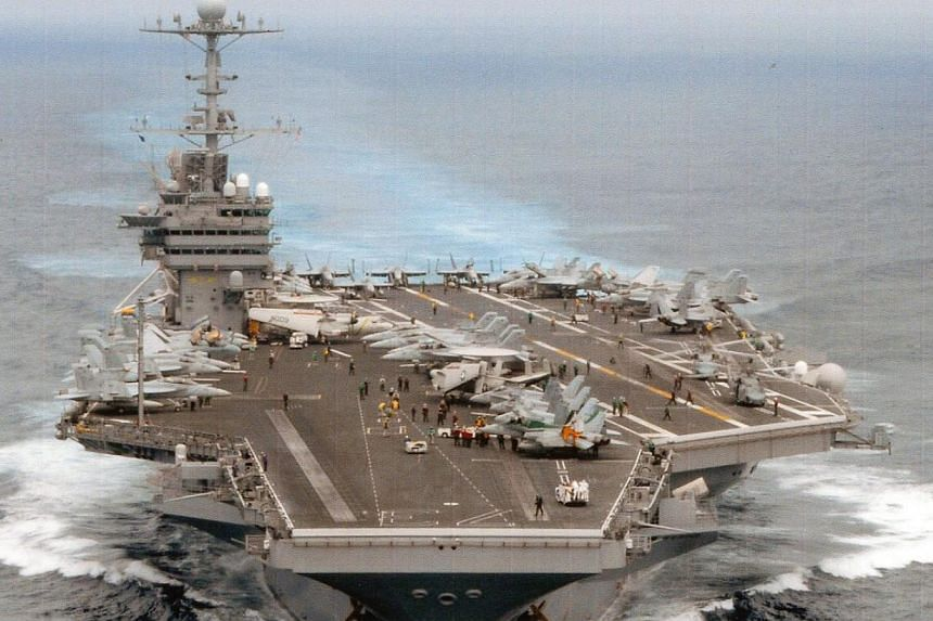The United States Navy on Sunday welcomed four members of China's military aboard the USS George Washington, one of its aircraft carriers - and said it hoped to receive a return invite someday. -- PHOTO: US NAVY