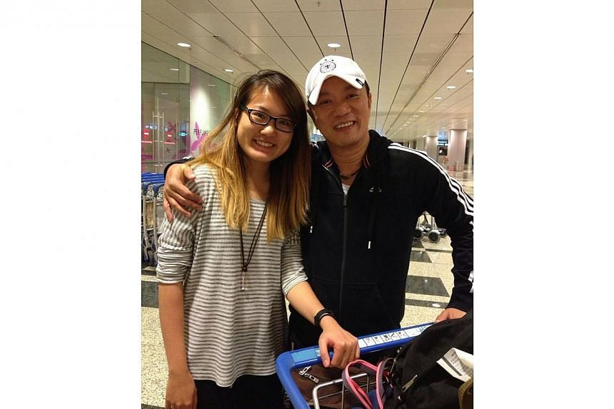 The author with her father, Mr Kenny Thor Kim Ho, at Changi Airport. -- ST PHOTO:VENESSA THOR