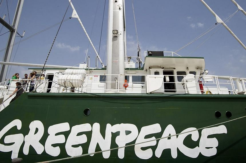 A Greenpeace employee has been fired after losing the environmental charity 3.8 million euros (S$6.4 million) in a failed gamble on international currency markets, the group said on Sunday, June 15, 2014. -- PHOTO: AFP