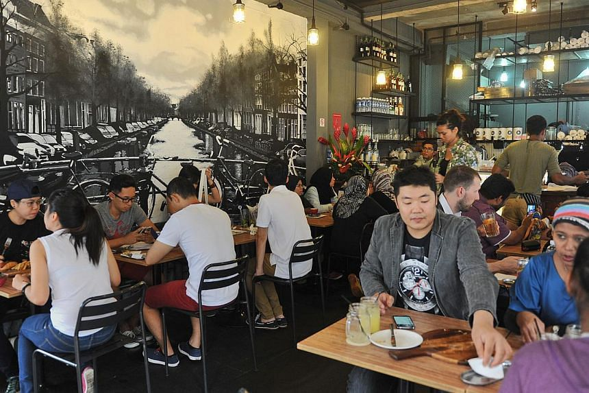 New eateries in the area include I Am cafe (above) at the junction of North Bridge Road and Haji Lane. -- ST PHOTO: MATTHIAS HO