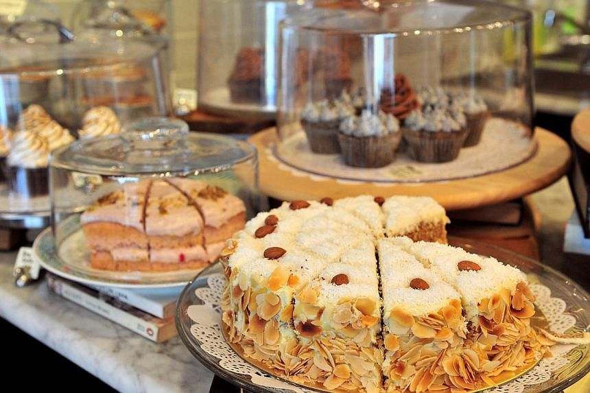(Above) The Pantry at Shop Wonderland sells cakes, coffee and savoury items. -- ST PHOTO: STEFFI KOH