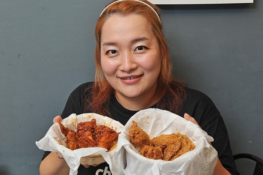Dishes to be found at Bali Lane include red velvet waffles at Stateland Cafe, pita bread at Pita Bakery and crispy fried chicken at Korean restaurant Choo Choo Chicken, co-owned by Ms Lee Soon Young, 33 (above). -- PHOTO: MATTHIAS HO