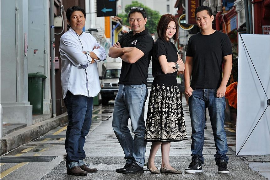 (From far left) New shop owners in Haji Lane include Mr Frank Yap, 38, of Al'Frank Cookies; Mr Wilson Lee and Ms Gina Kwok of Eisky Fabulous; and Mr Clement Chin, 25, of Koi Bangers + Izakaya. -- ST PHOTO: MATTHIAS HO
