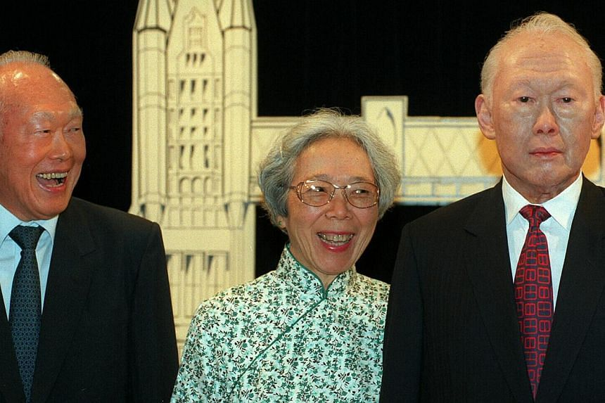 2. Then Senior Minister Lee Kuan Yew and his wife posing with a Madame Tussauds wax sculpture of himself in a 1998 photo. -- ST FILE PHOTOS