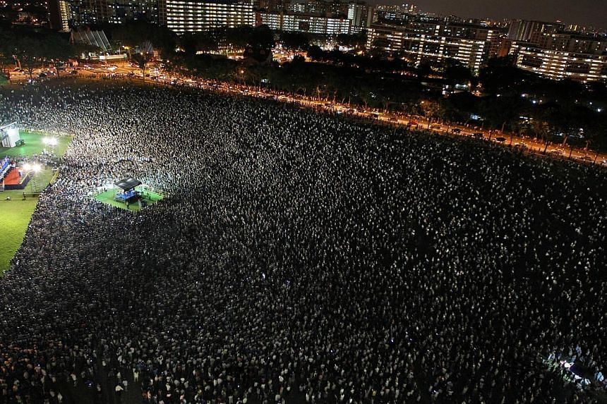3. A shot of 15,000 or so people at a Workers' Party rally in Hougang Central during the 2011 elections. -- ST FILE PHOTOS
