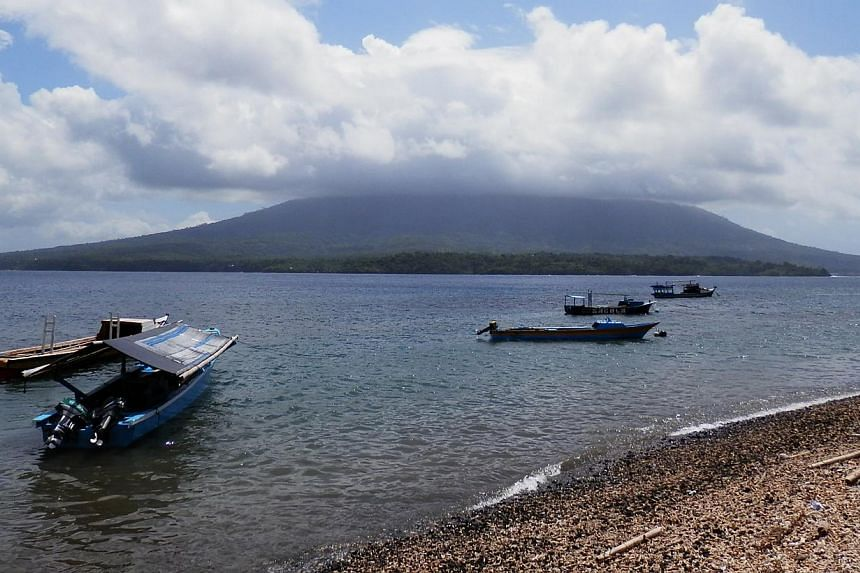 Mount Gamalama takes four hours to climb and its volcanic soil nourishes the clove, nutmeg, cinnamon and other spices on Ternate island. -- ST PHOTO: ZAKIR HUSSAIN