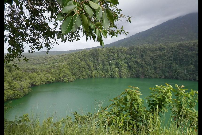 Batu Angus or scorched rocks were formed by molten flowing lava from the volcano when it erupted in 1673, and Big Tolire Lake (above) is a popular picnic spot where visitors like to toss stones into the water that never seem to hit the bottom. -- ST
